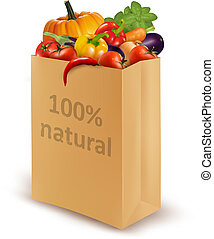 100 percent natural on a paper bag full of fresh vegetables...