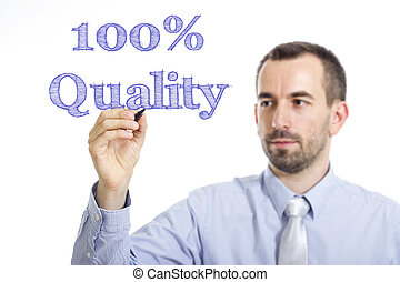 100% Quality - Young businessman writing blue text on transparent surface