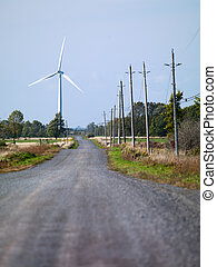 100 road with wind mill in the background