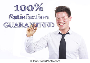100% Satisfaction GUARANTEED - Young smiling businessman writing on transparent surface