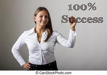 100% Success - Beautiful girl writing on transparent surface