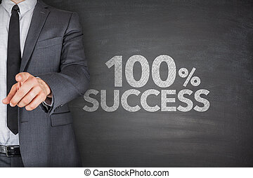 100% success text with businessman standing by