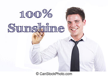 100% Sunshine - Young smiling businessman writing on transparent surface