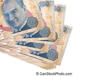 100 Turkish liras bills lies in small bunch or pack isolated on white. Mockup with copy space. Business and currency exchange concept