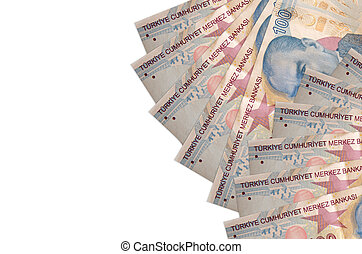 100 Turkish liras bills lies isolated on white background with copy space. Rich life conceptual background