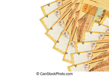 1000 Kazakhstani tenge bills lies isolated on white background with copy space. Rich life conceptual background