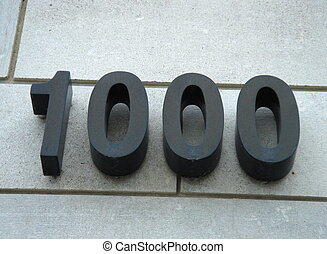 1000 number written in black on a wall