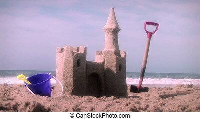 (1001) Sandcastle and Toys on Beach, Summer