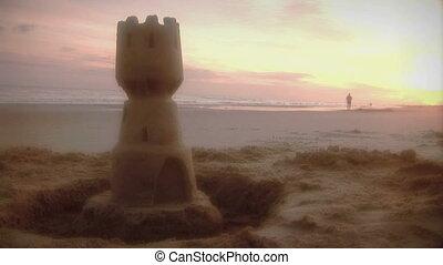 (1006) Shoreline jogger on beach at sunrise