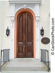 Arched doorway with steps and hand rails