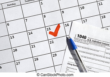 1040 Individual Income Tax Return blank and pen on calendar page with marked 15th April