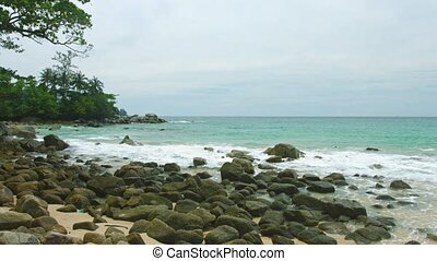 Panoramic view of a beach with sand and rocks. Thailand, Phuket