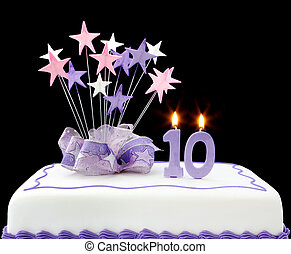 10th Cake - Fancy cake with number 10 candles. Decorated...