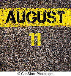 11 August calendar day over road marking yellow paint line