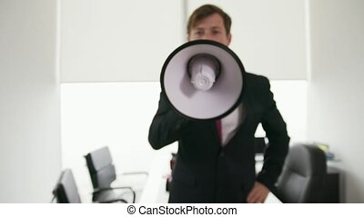 11 White Collar Office Worker Talking With Megaphone At Camera