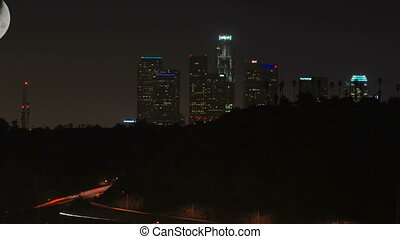 This is a zooming timelapse shot of downtown Los Angeles and the 110 freeway from Highland Park.
