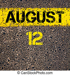 12 August calendar day over road marking yellow paint line