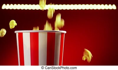 Two red bowls full of popcorns on red background for film, TV, television watching. Concept of couple having a movie night. Super slowmotion 120p