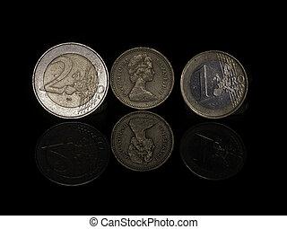 1,2 euro plus 1 pound ? - Pound and Euro coins on Black