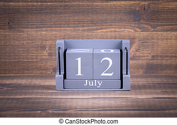 12 July. Wooden, square calendar