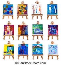 Twelve mini paintings on easels isolated on white