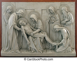 13th Stations of the Cross, Jesus' body is removed from the...