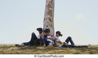 14-Black And White Teenagers Playing Virtual Reality In Park
