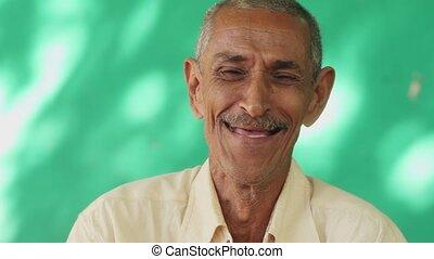 14 People Portrait Happy Elderly Hispanic Man Laughing At Camera