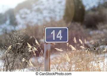 14 sign on the road in nature
