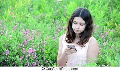 14 year girl writing sms on phone