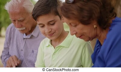 16-Child Helping Grandparents Going Internet On Phone