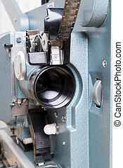 close up on the lens of a 16 mm film projector