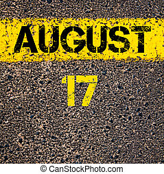 17 August calendar day over road marking yellow paint line