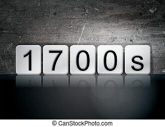 "The word ""1700s "" written in white tiles against a dark vintage grunge background."