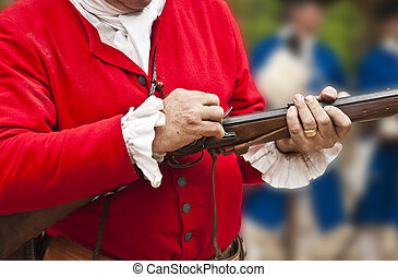 18th century soldier carrying a rifle