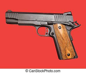 1911 pistol - 1911 style pistol on a red background.