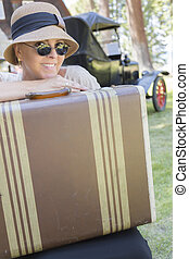 1920s Dressed Girl With Suitcase Near Vintage Car