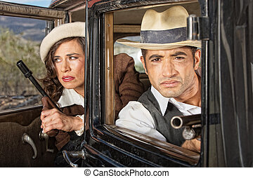 1920s Lookout Gangsters - Gangster couple on lookout in...