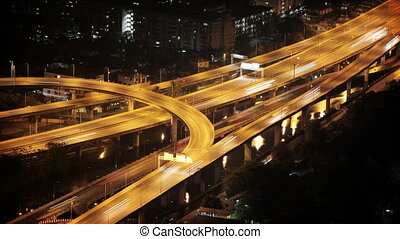 Road interchange in the night city