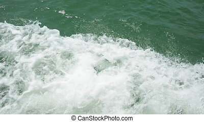 Water foam near the prow of the ship
