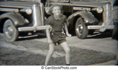 1937: Girls rollerskating on the - Original vintage 8mm film...