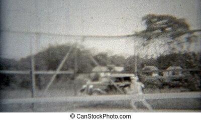 1937: Tennis play