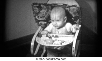(1940's 8mm Vintage) Baby Bouncing - A black and white of a...