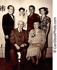 1940s FAMILY PHOTO - Three men and three women pose for a...