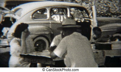 1949: Family playing poker outdoors - Vintage 8mm film home...