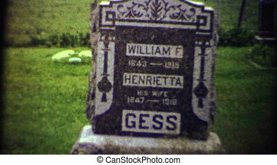 (1950s 8mm Vintage) Old Gravestone - A creepy closeup of a...