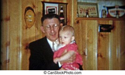 1953: Grandparents holding baby for - Original vintage 8mm...