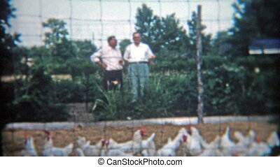1953: Men overlooking a chicken - Original vintage 8mm film...