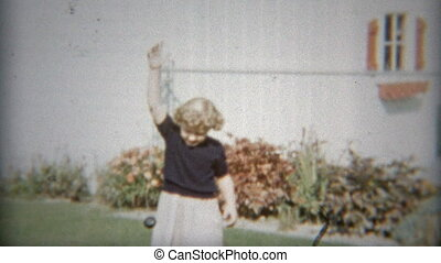 1953: Young girl playing outdoors - Original vintage 8mm...