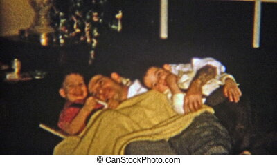 1954: Sons cuddling on couch with - Vintage 8mm film home...